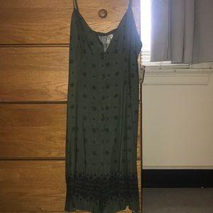 Green romper with black print